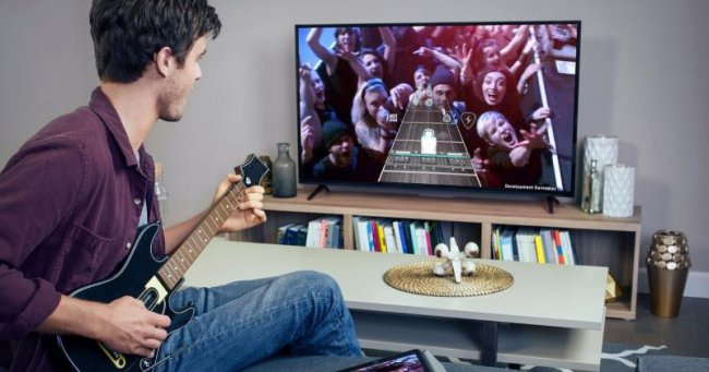 Guitar Hero available Live on Apple TV, and it's impossible to miss